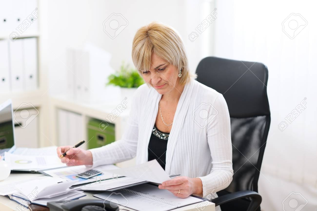 Mature business woman working at office Stock Photo - 12637783