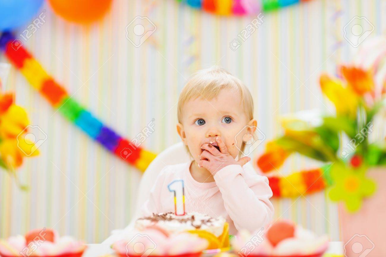 Kid eating first birthday cake Stock Photo - 12930586