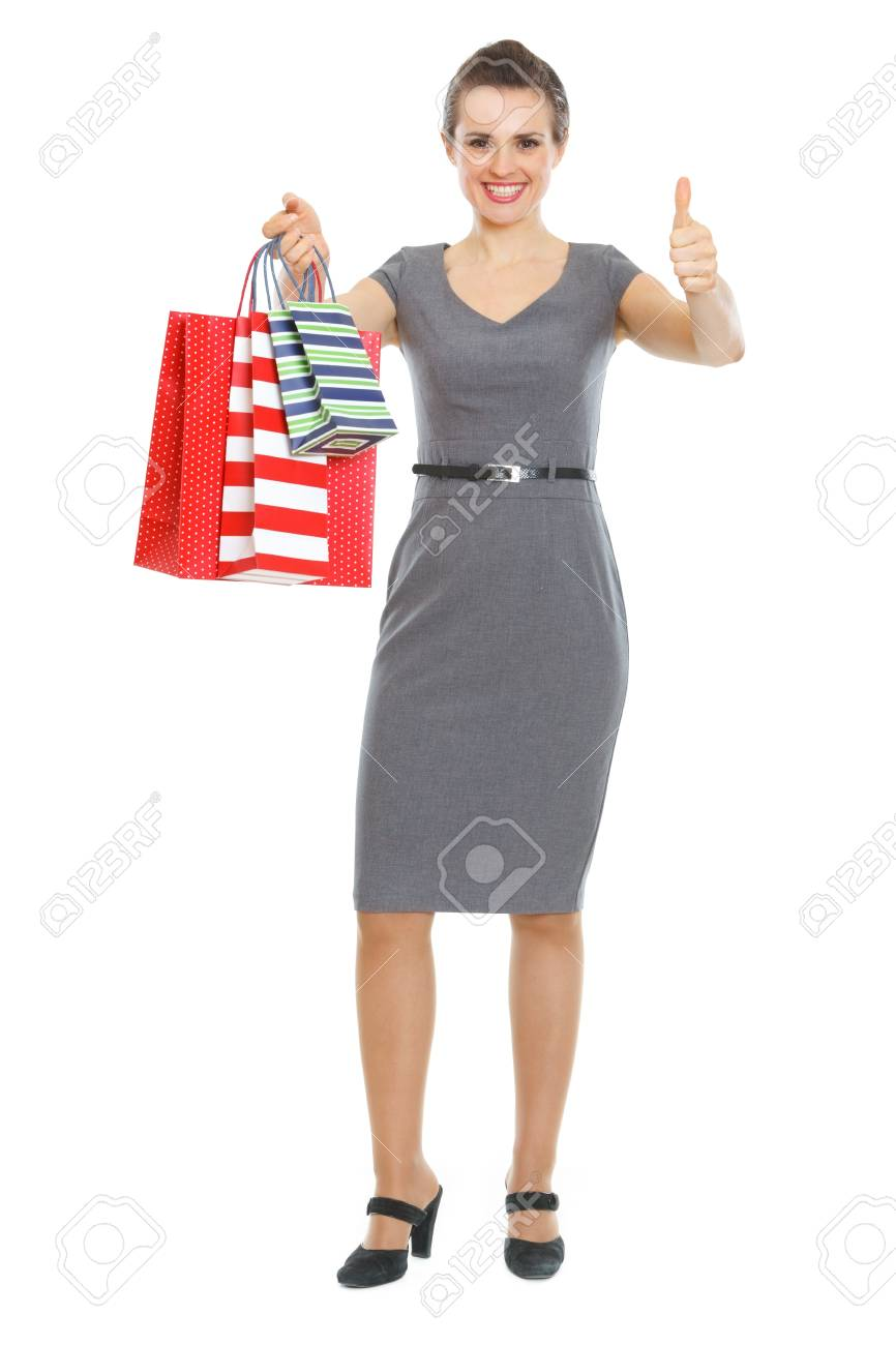Happy elegant woman with shopping bags showing thumbs up Stock Photo - 12930660