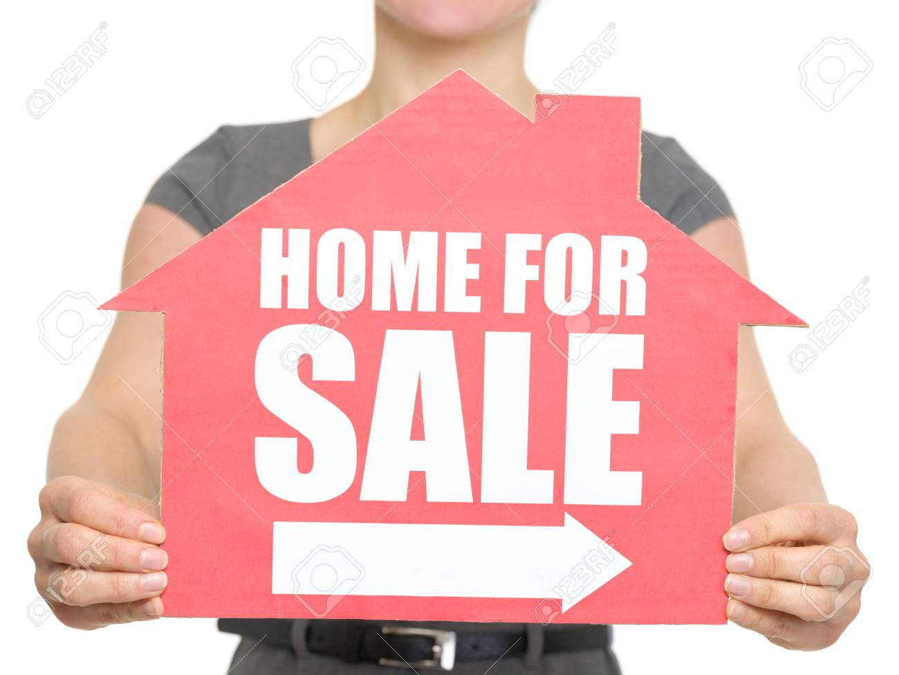 Closeup on home for sale sign in female hand. Stock Photo - 13213145