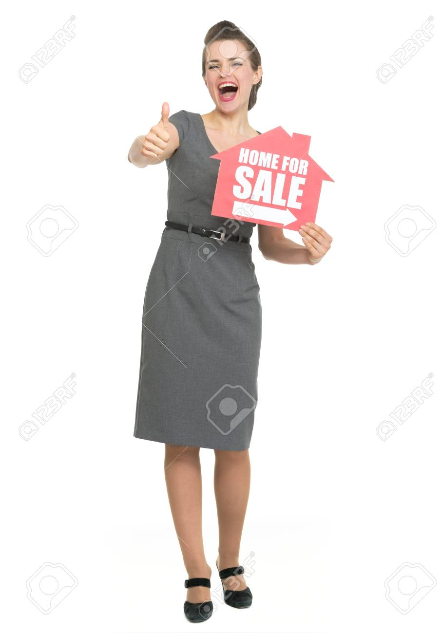 Smiling realtor showing thumbs up and home for sale sign Stock Photo - 13611518
