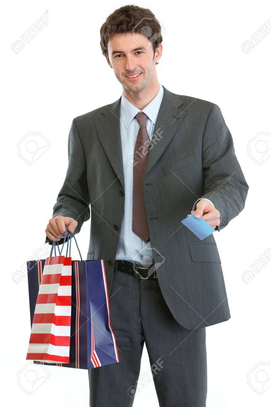 Man in suit holding shopping bags and credit card Stock Photo - 13702188