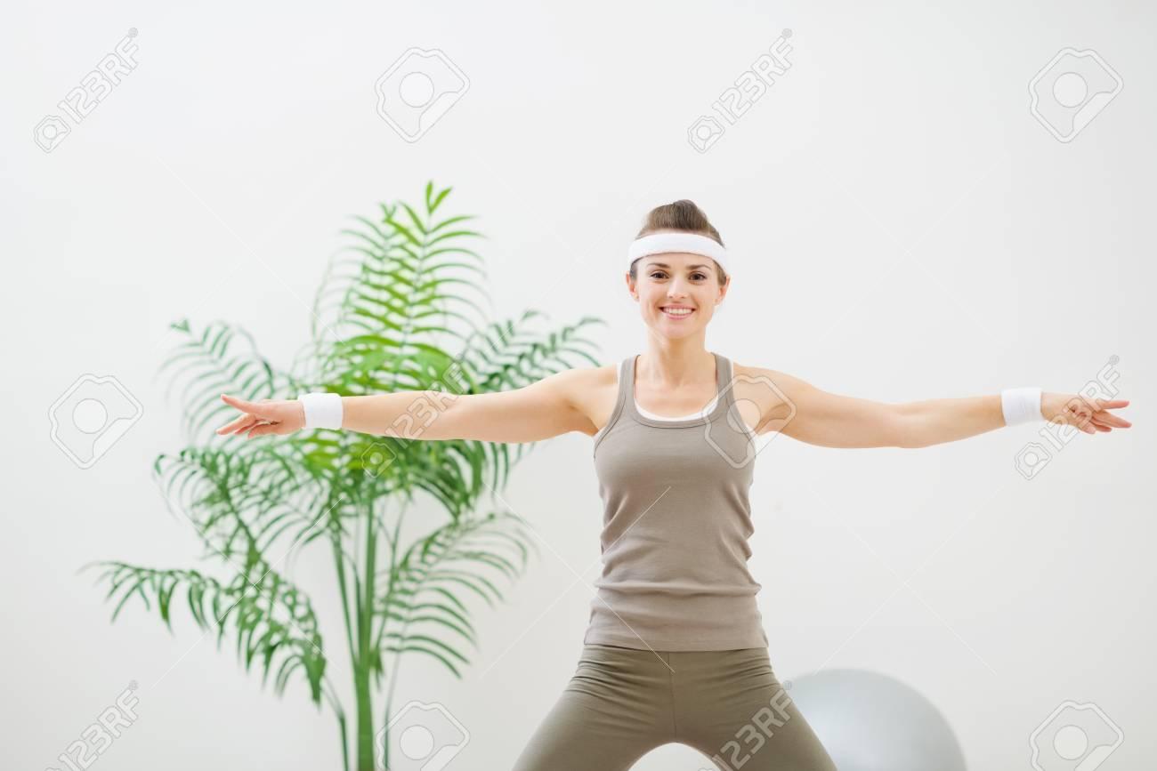 Healthy woman making gymnastics Stock Photo - 13743306
