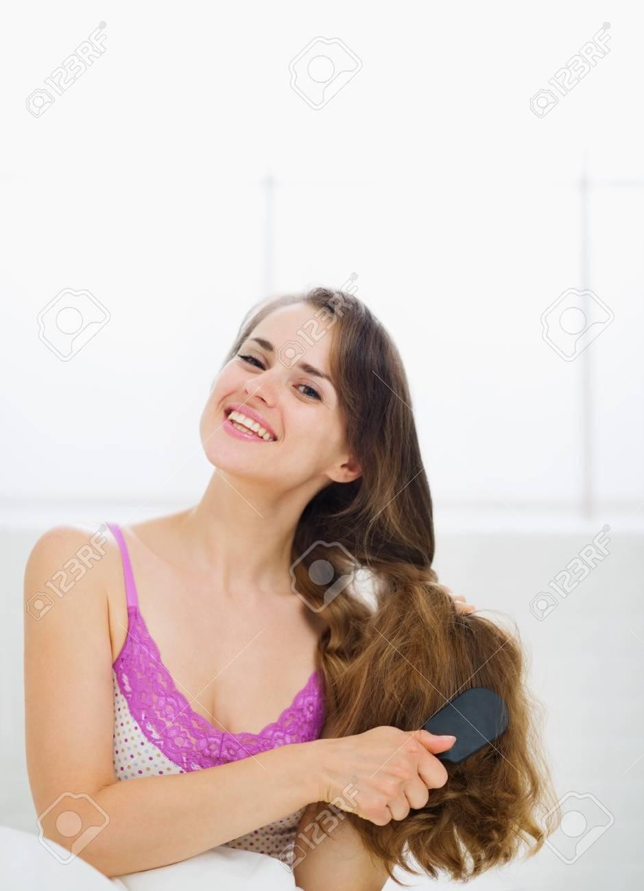 Beautiful woman combing luxury long hair Stock Photo - 13817632