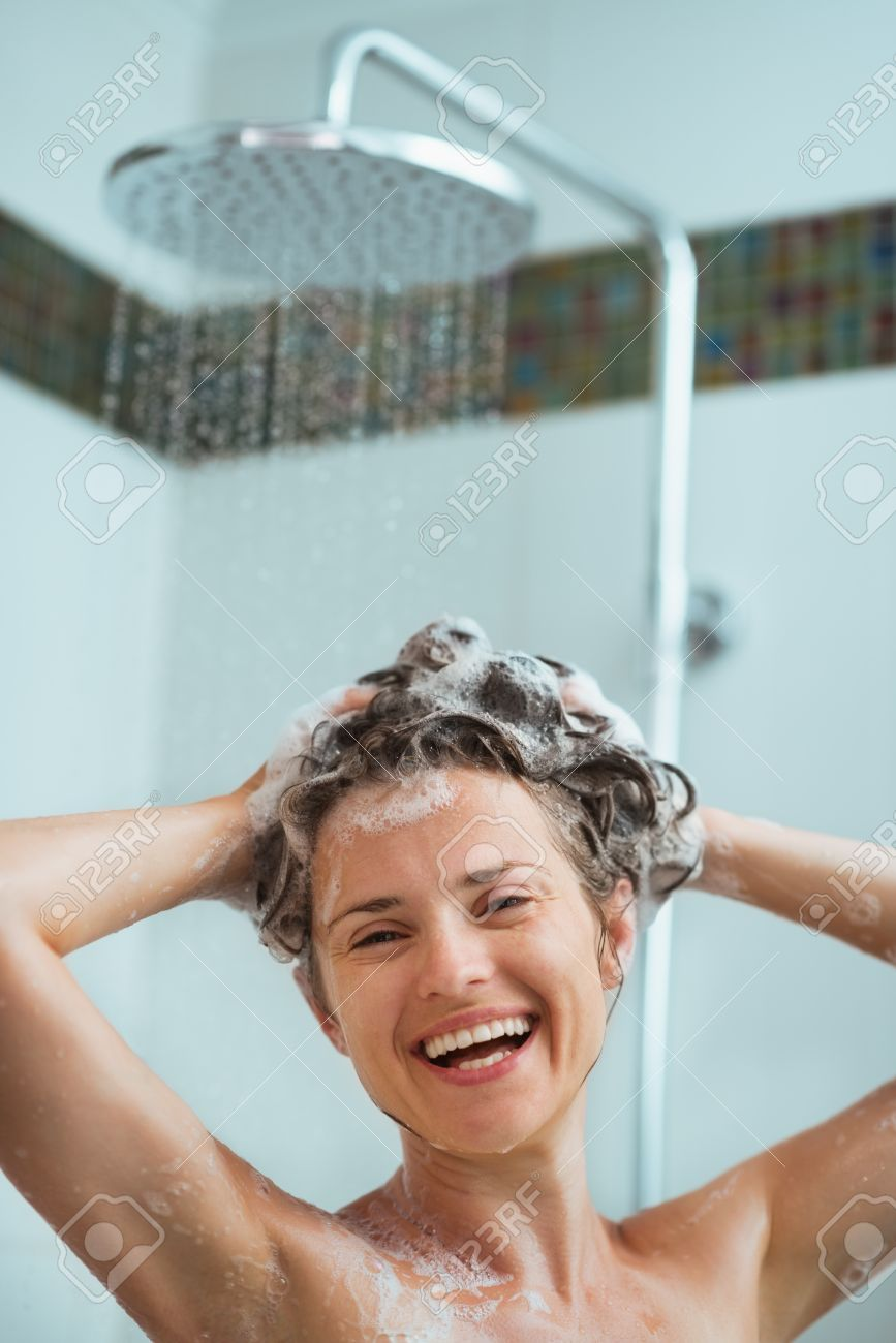 Happy Woman Applying Shampoo In Shower Stock Photo, Picture And ...