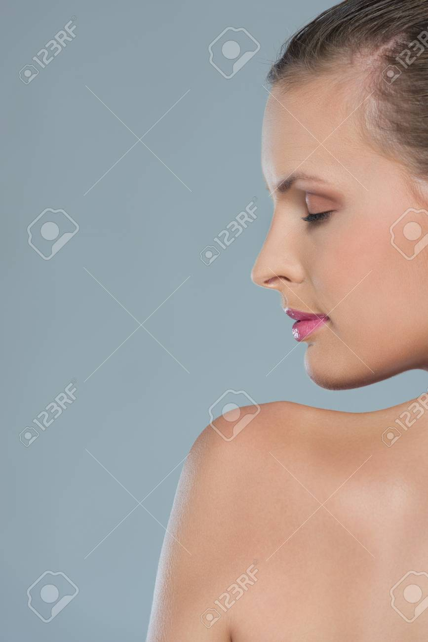 Beauty portrait of young woman in profile isolated on gray Stock Photo - 14634479