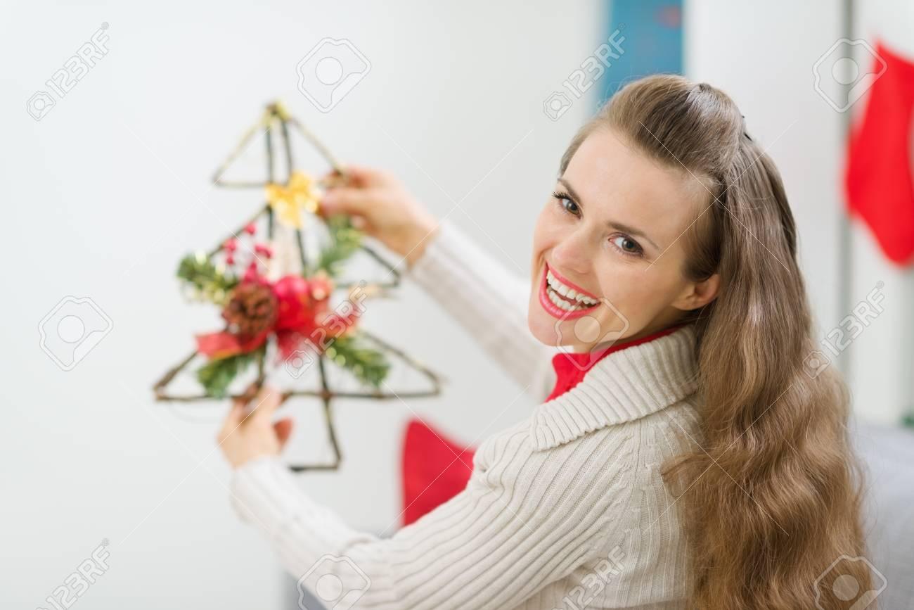 Smiling woman holding Christmas decoration tree Stock Photo - 14901644