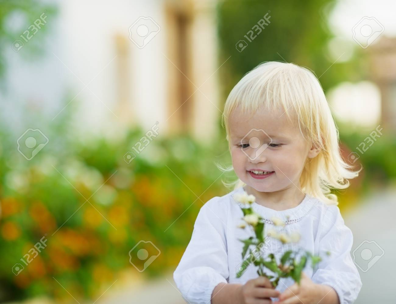 Portrait of baby with flowers outdoors Stock Photo - 15652310