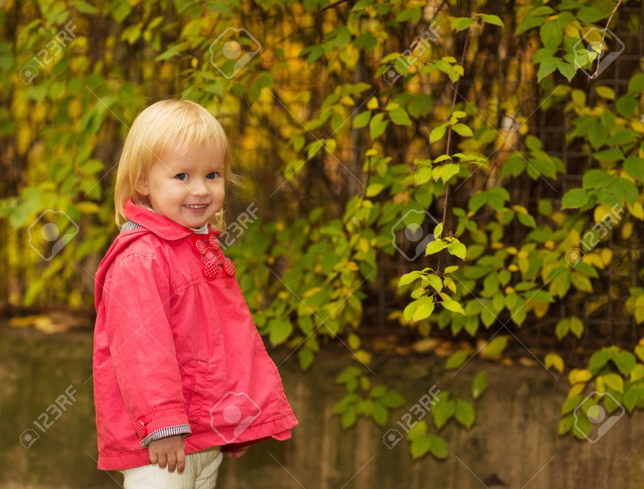 Portrait of baby in red coat outdoors Stock Photo - 16084850