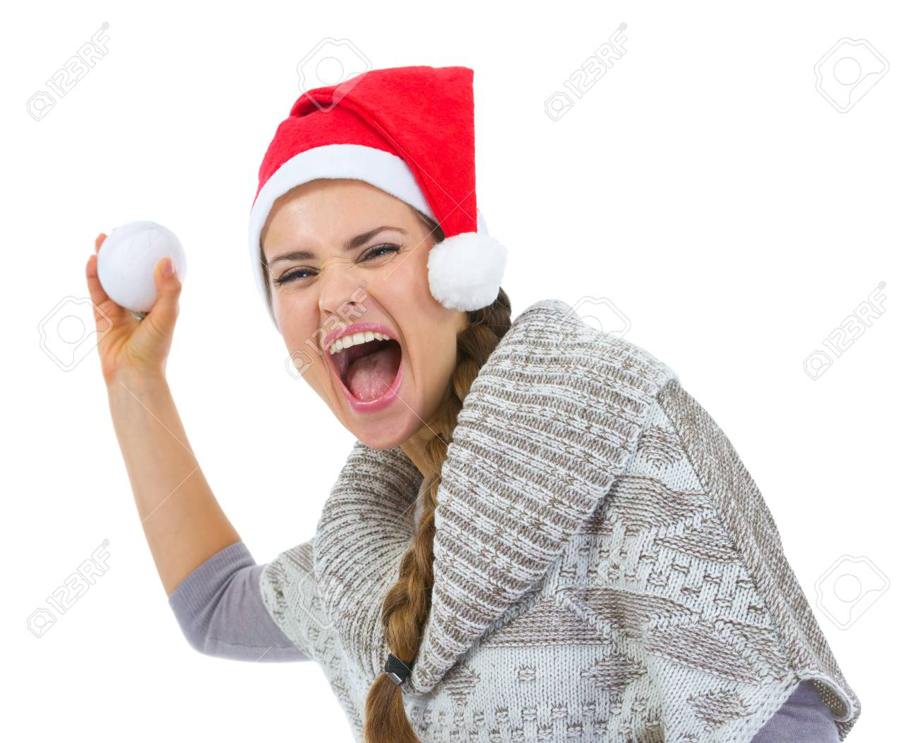 Cheerful woman in Santa hat throwing snowball Stock Photo - 16336959