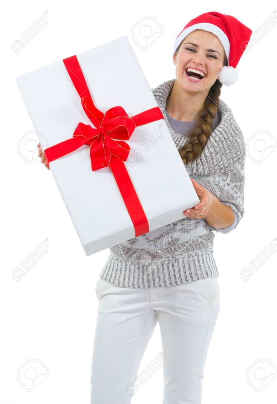 Happy woman in Santa hat holding big Christmas present Stock Photo - 16336951