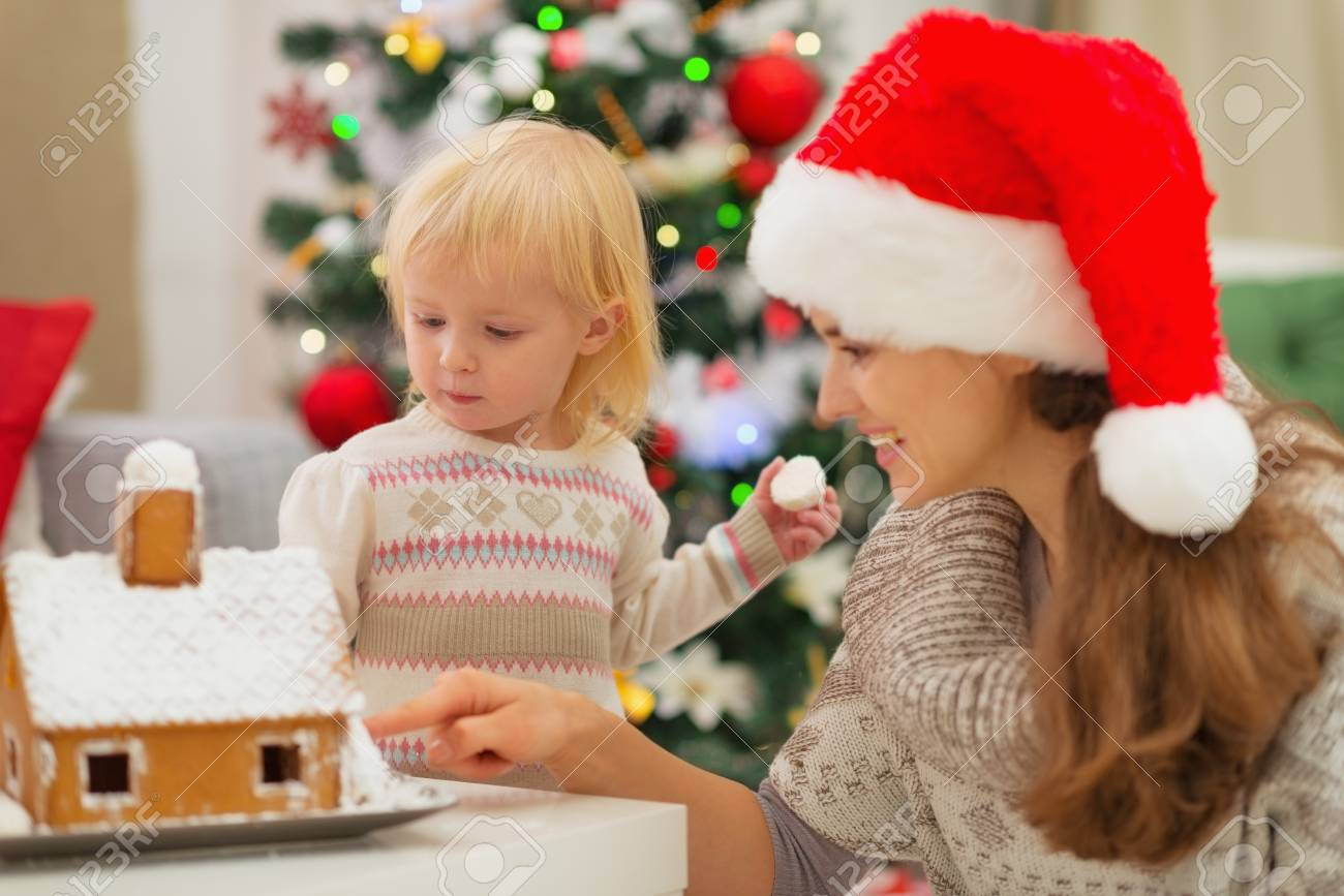 Mother showing baby Christmas Gingerbread House Stock Photo - 16577971