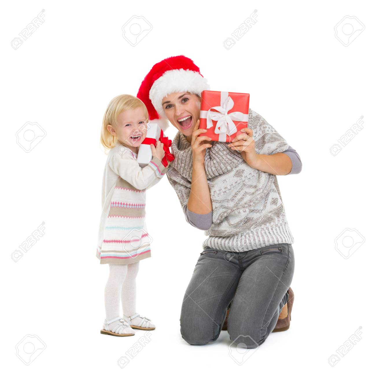 Mother And Baby Peekaboo From Christmas Present Boxes Stock Photo ...