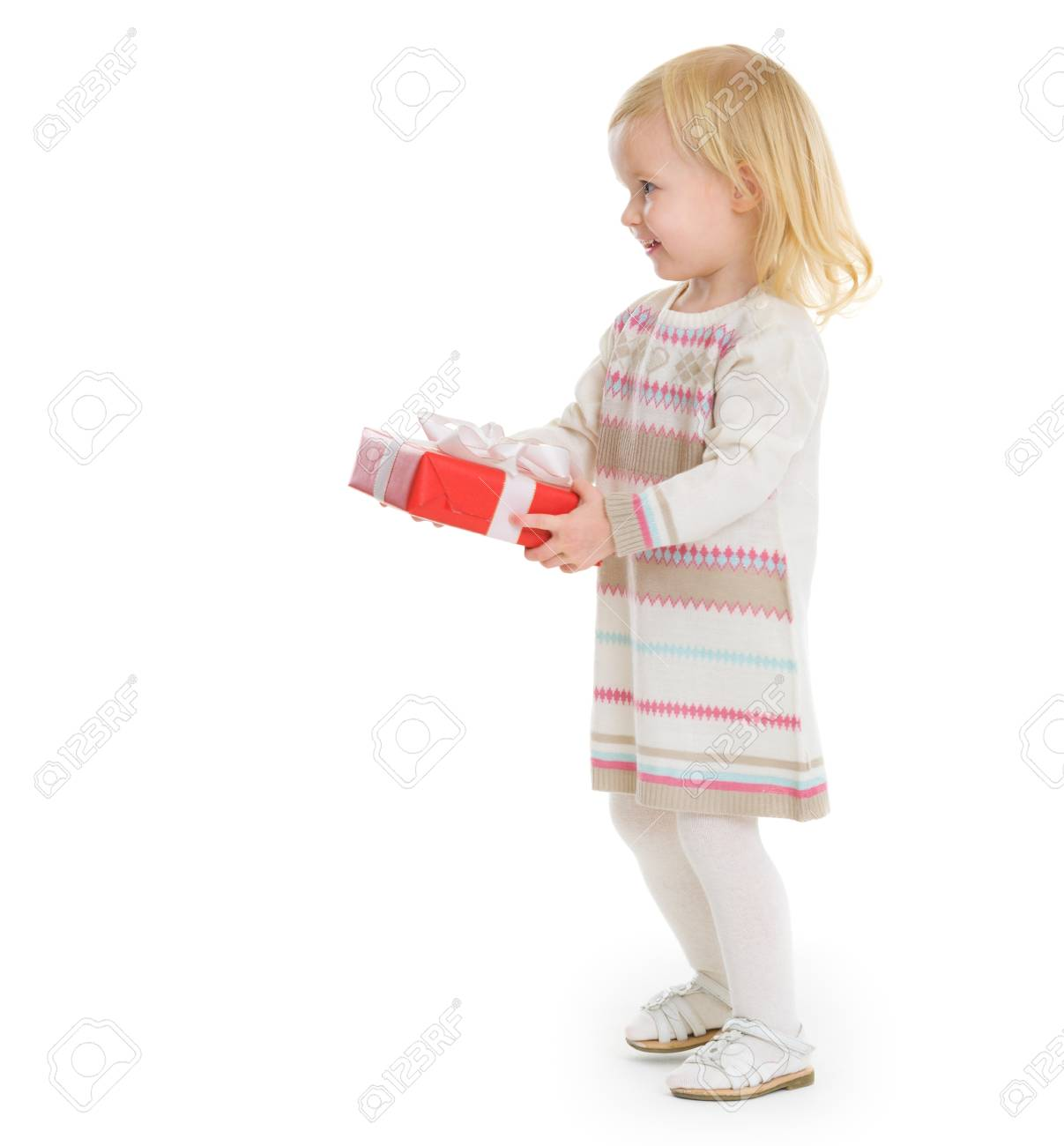Happy baby girl holding Christmas present box Stock Photo - 16577930