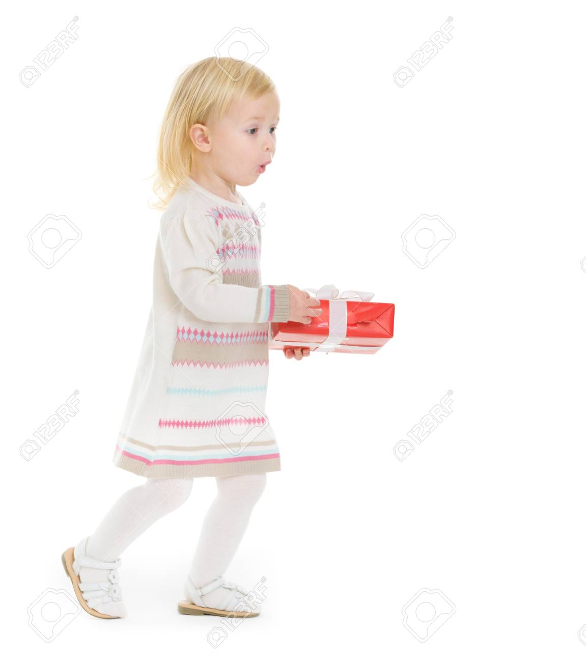 Surprised baby girl with Christmas present box Stock Photo - 16577928