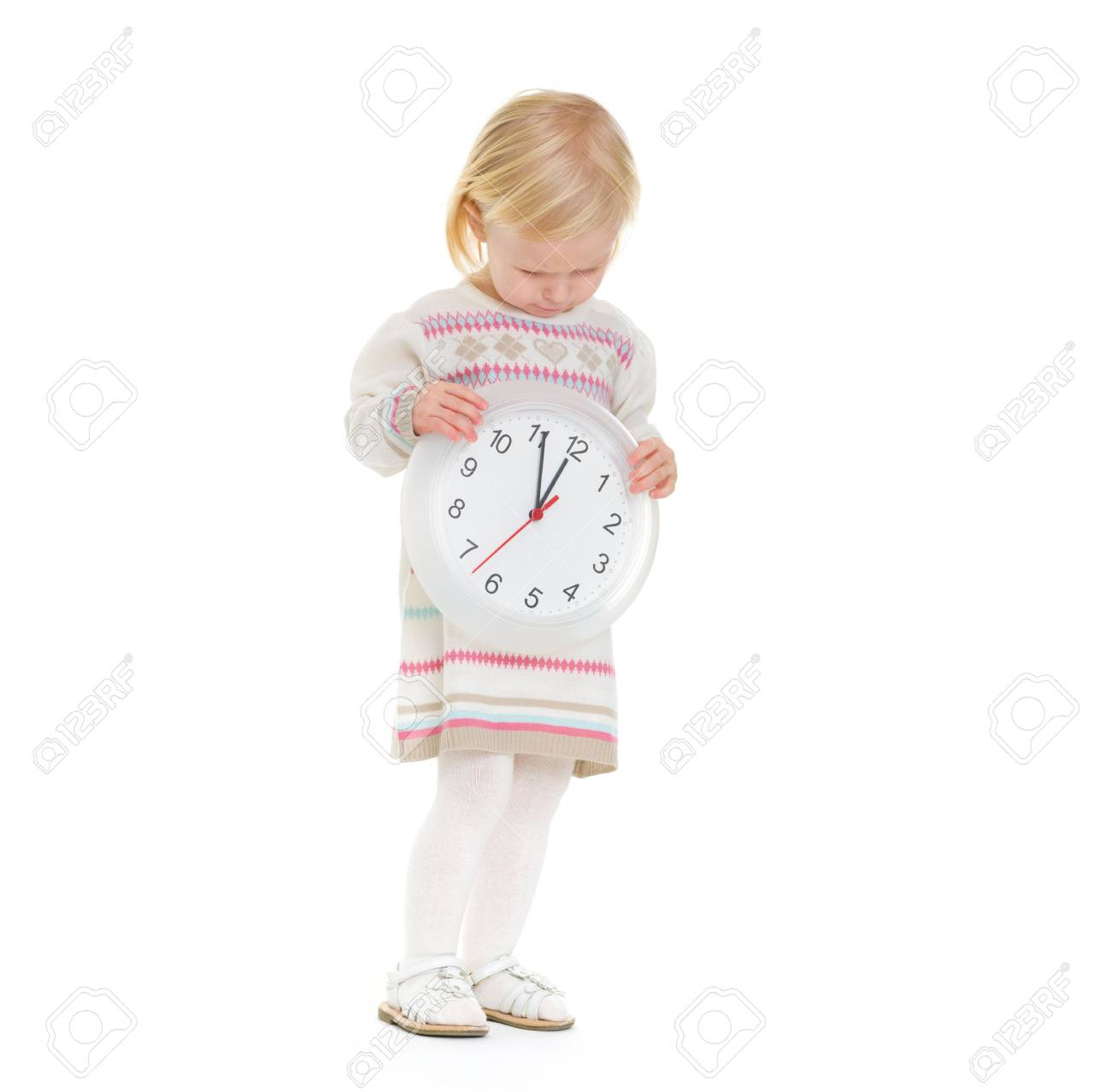 Christmas portrait of baby girl looking on clock Stock Photo - 16577929