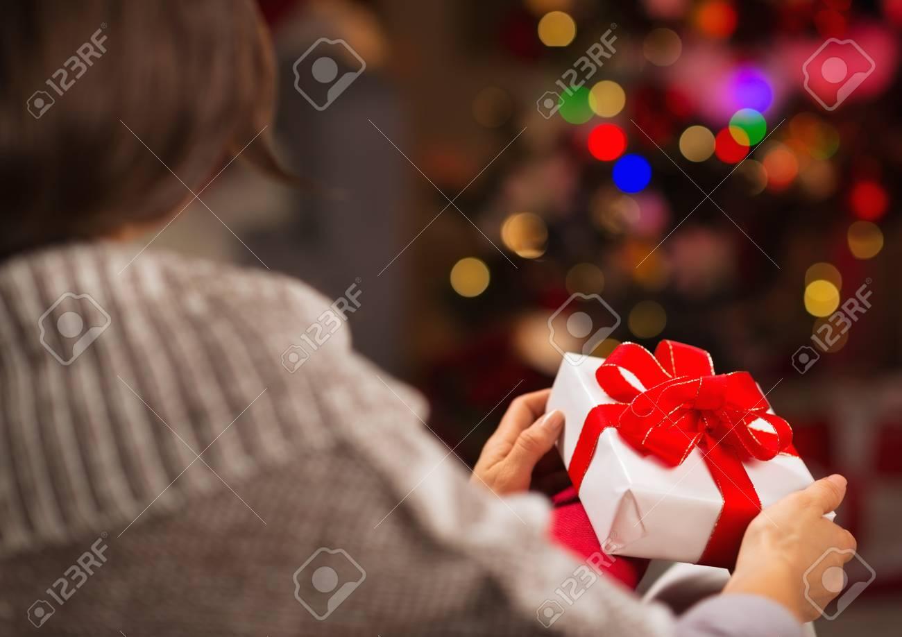 Woman holding Christmas present box. Rear view Stock Photo - 16711023