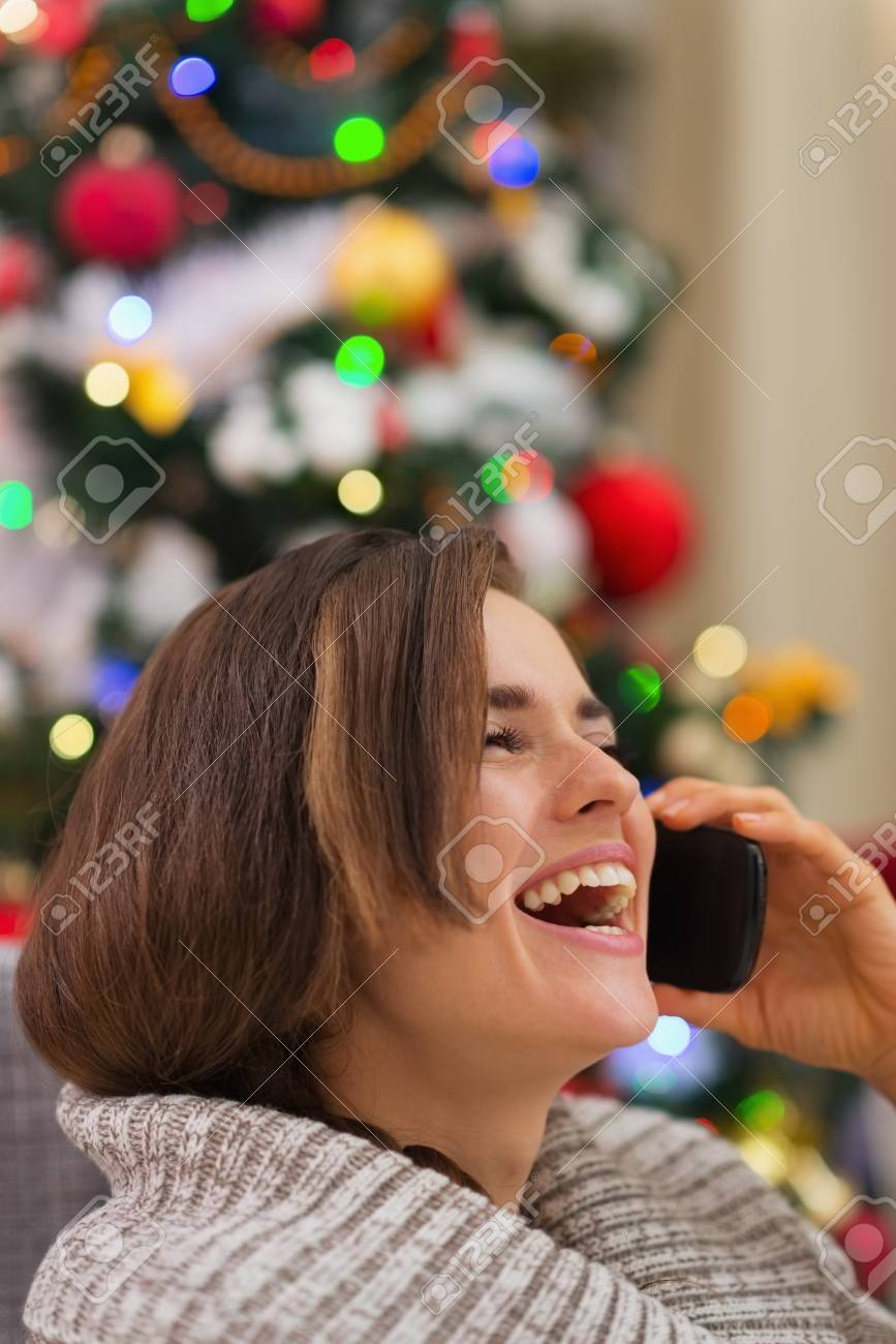 Portrait of smiling woman speaking mobile near Christmas tree Stock Photo - 16720138