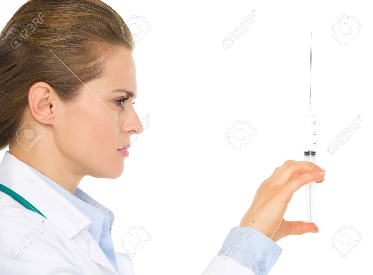 Closeup on medical doctor woman holding syringe Stock Photo - 17056173