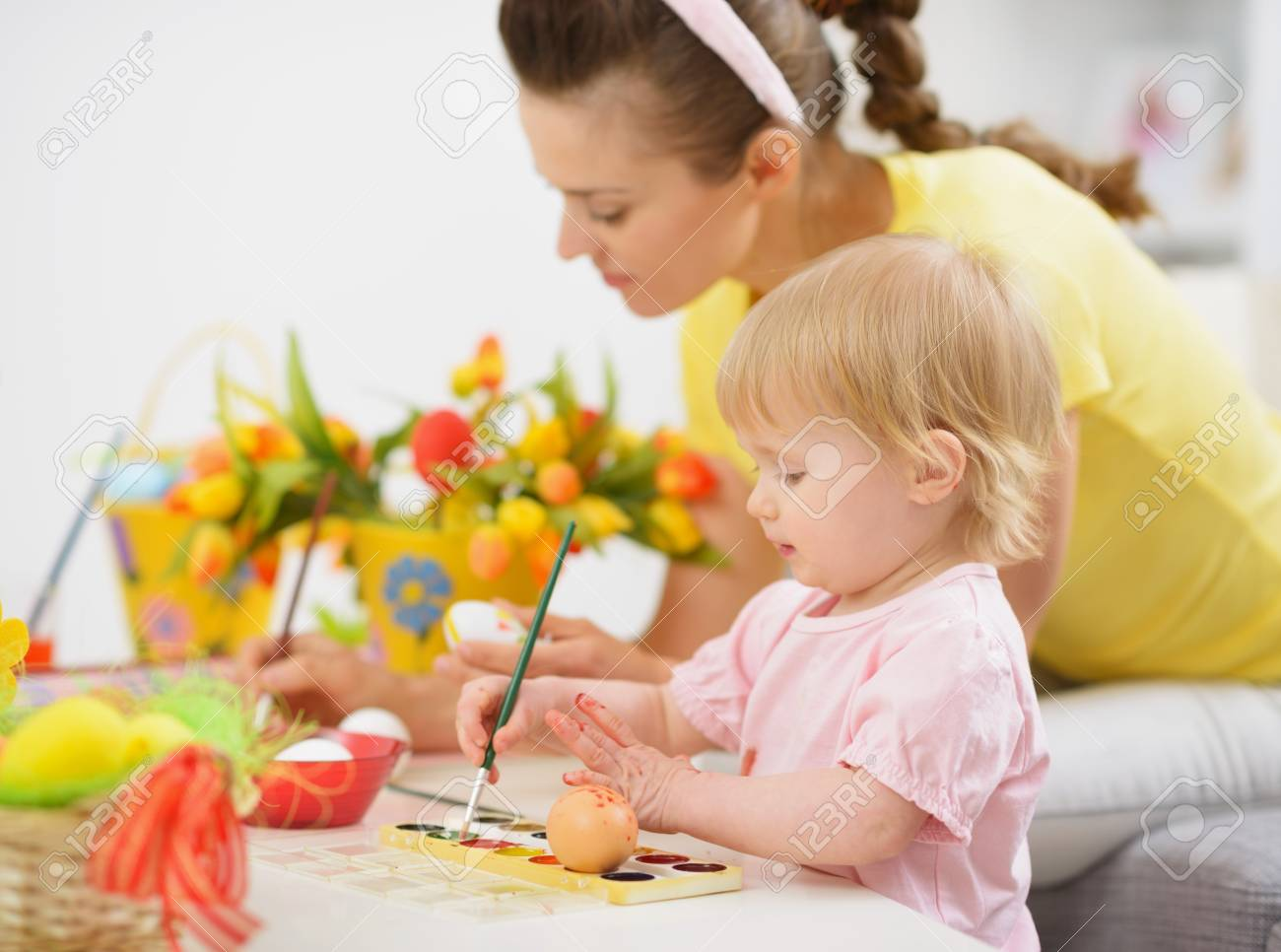 Mother and baby making Easter decorations Stock Photo - 17304861