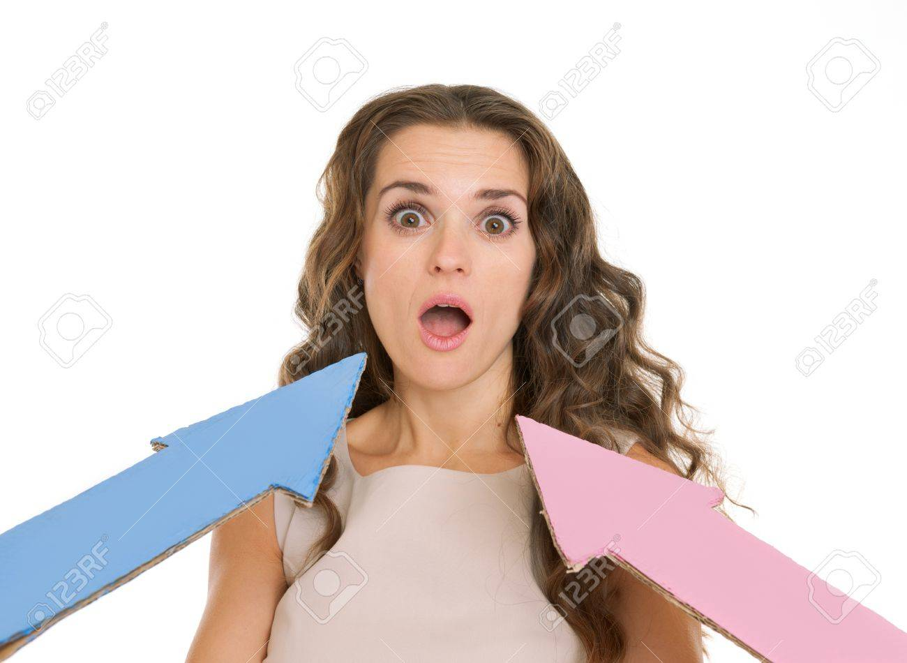 Arrows points on confused young woman Stock Photo - 17382830