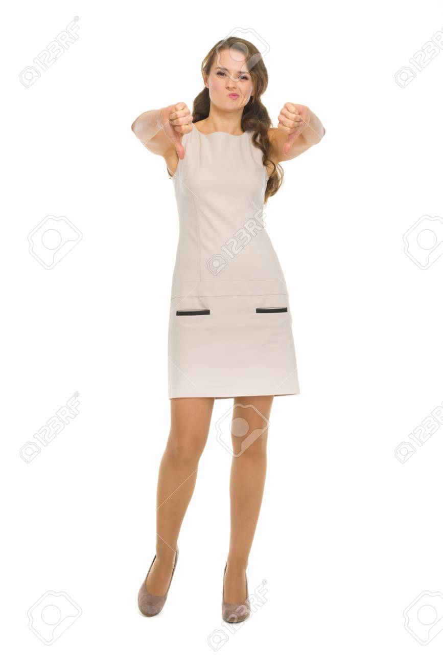 Full length portrait of young woman showing thumbs down Stock Photo - 17382842
