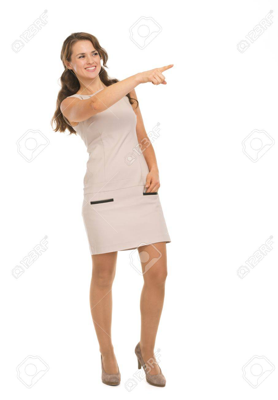 Full length portrait of happy young woman pointing on copy space Stock Photo - 17382856
