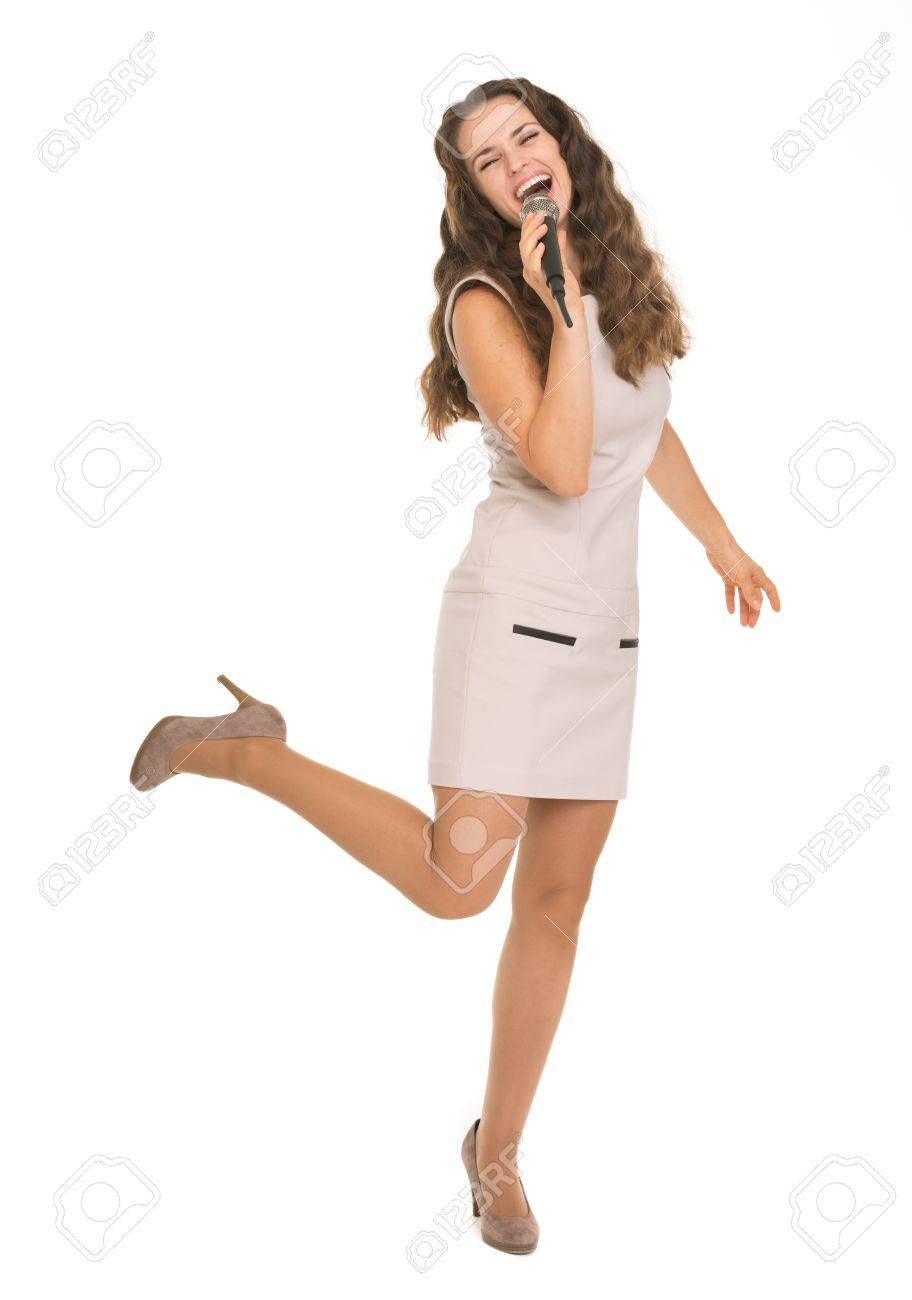 Full length portrait of happy young woman singing with microphone Stock Photo - 17382849