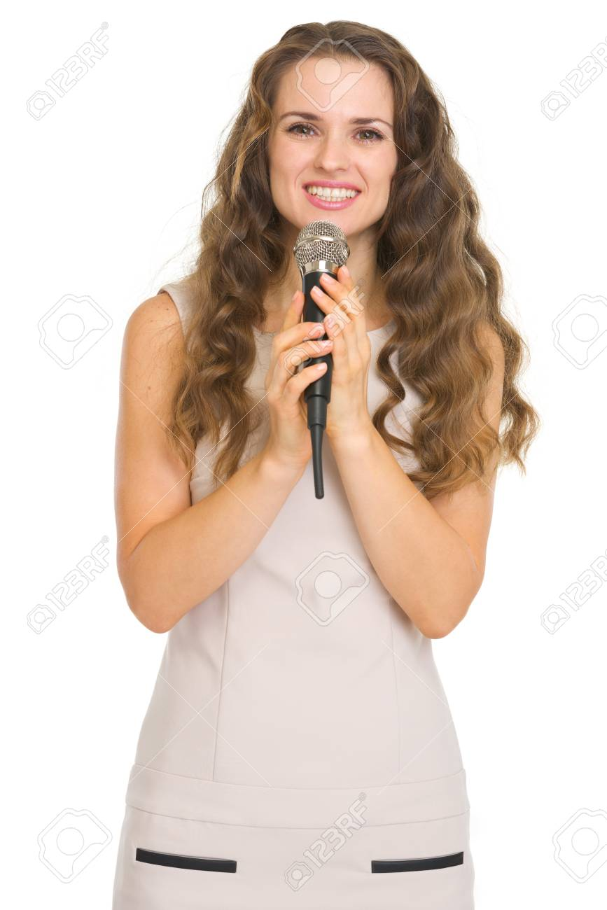 Portrait of smiling young woman with microphone Stock Photo - 17382788