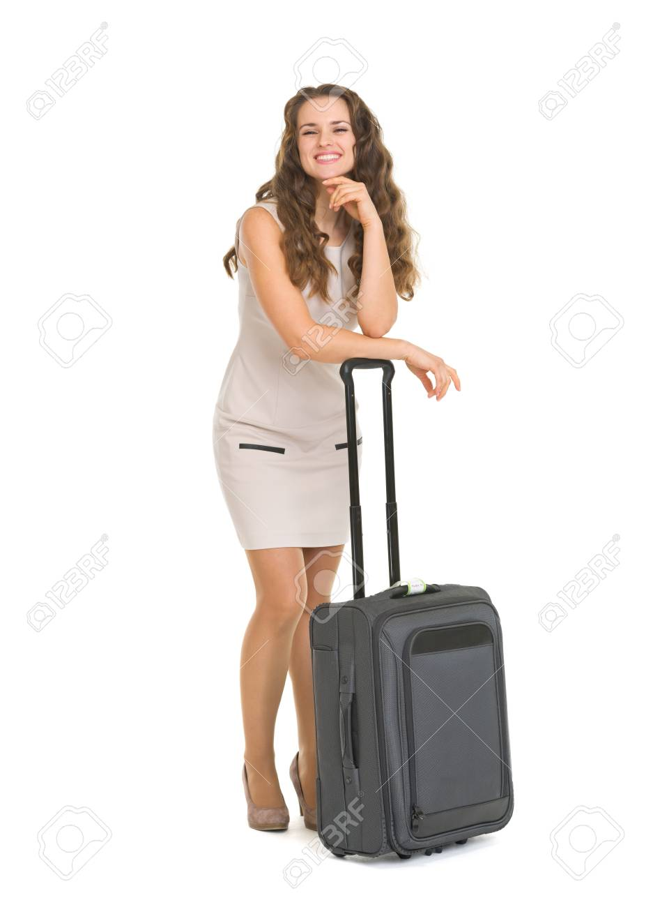Full length portrait of happy young woman leaning on wheels suitcase Stock Photo - 17382828