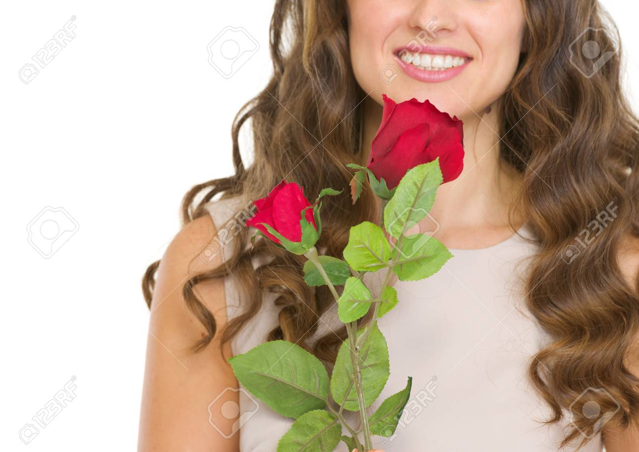 Closeup on young woman with red rose Stock Photo - 17418544