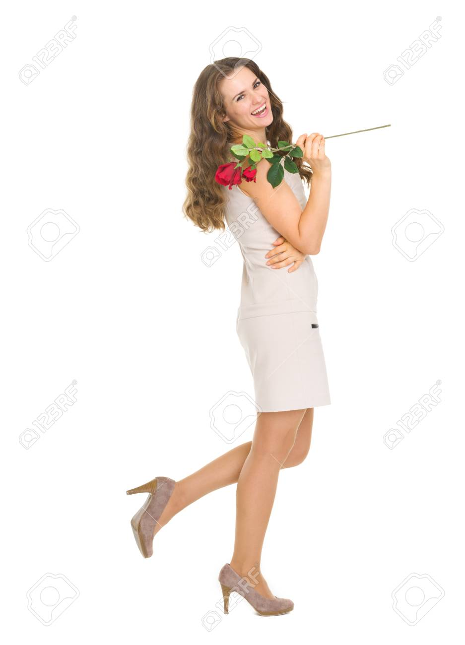 Full length portrait of happy young woman with red rose Stock Photo - 17417826