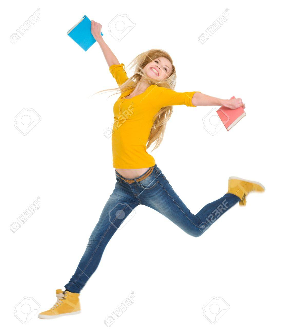 Happy student girl with books jumping Stock Photo - 17417807