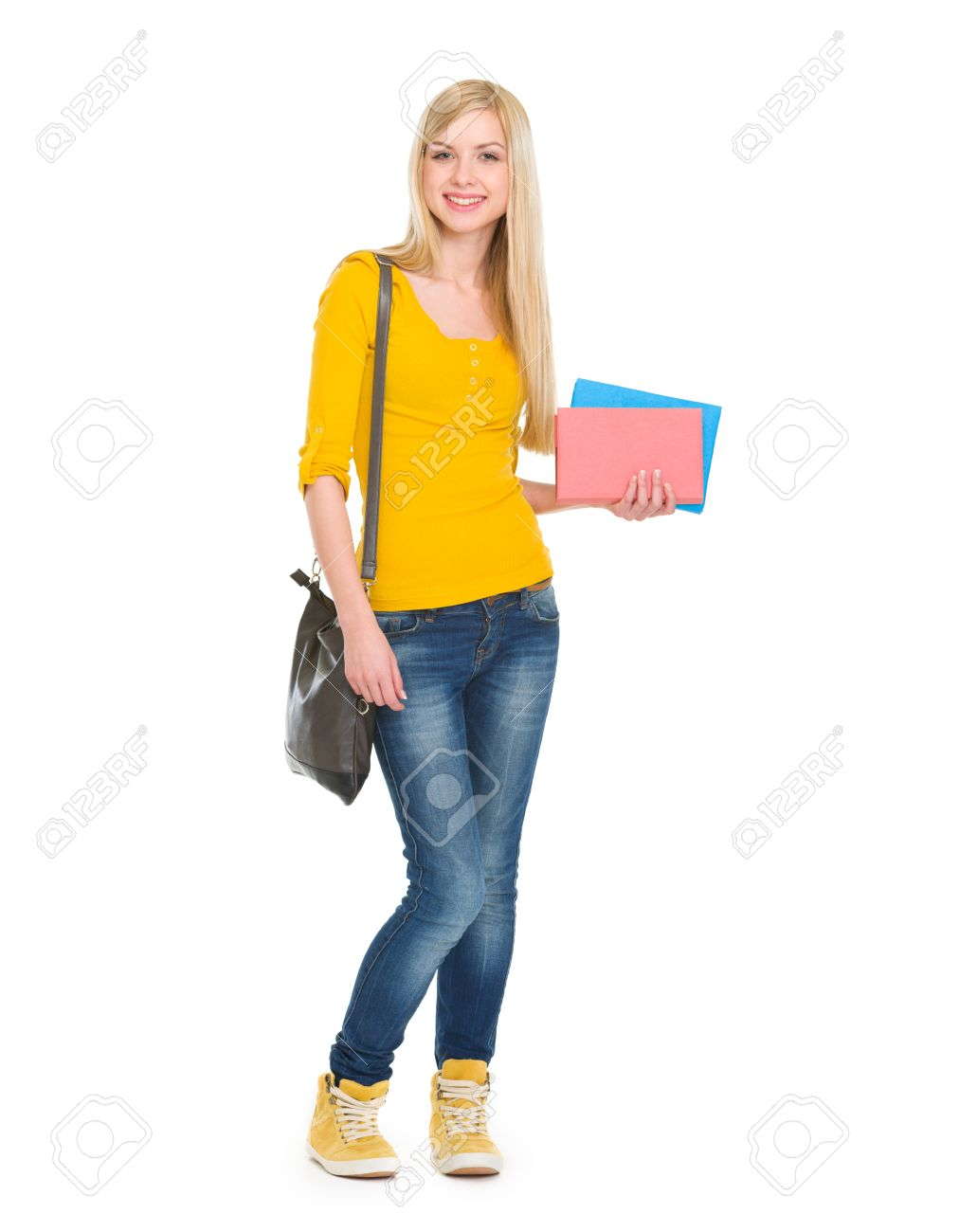 Full length portrait of teenage student girl with books Stock Photo - 17417825