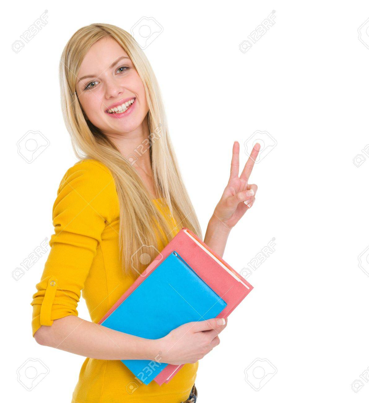 Happy student girl showing victory gesture Stock Photo - 17417827