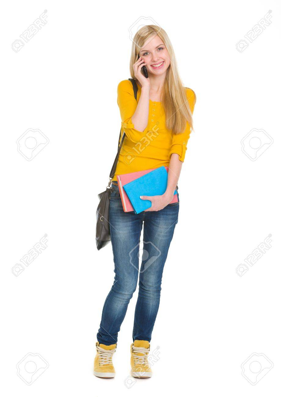 Full length portrait of happy student girl speaking mobile Stock Photo - 17417836