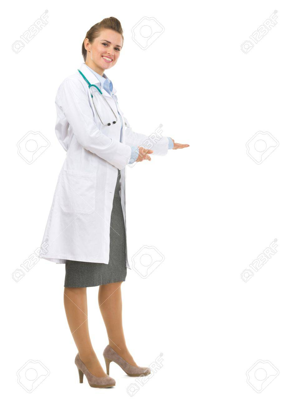 Full length portrait of medical doctor woman inviting to come Stock Photo - 17563384
