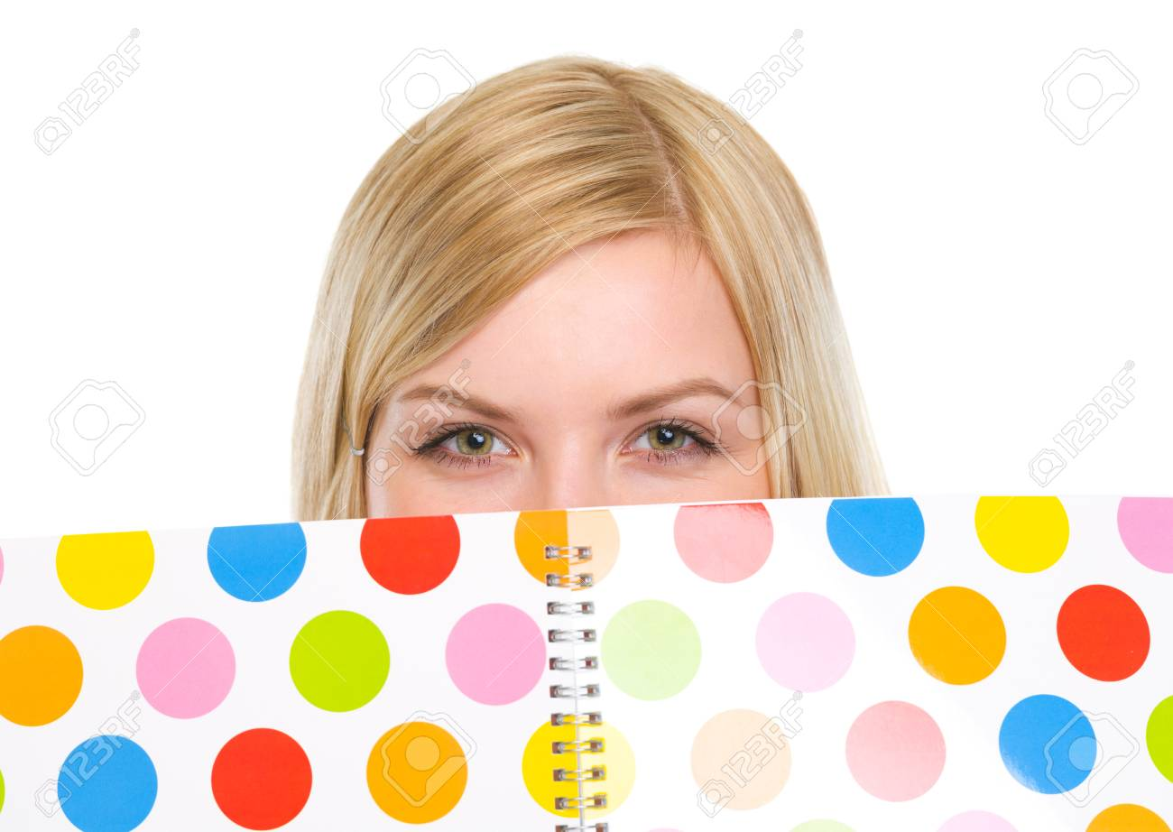 Closeup on student girl hiding behind notebook Stock Photo - 18204746