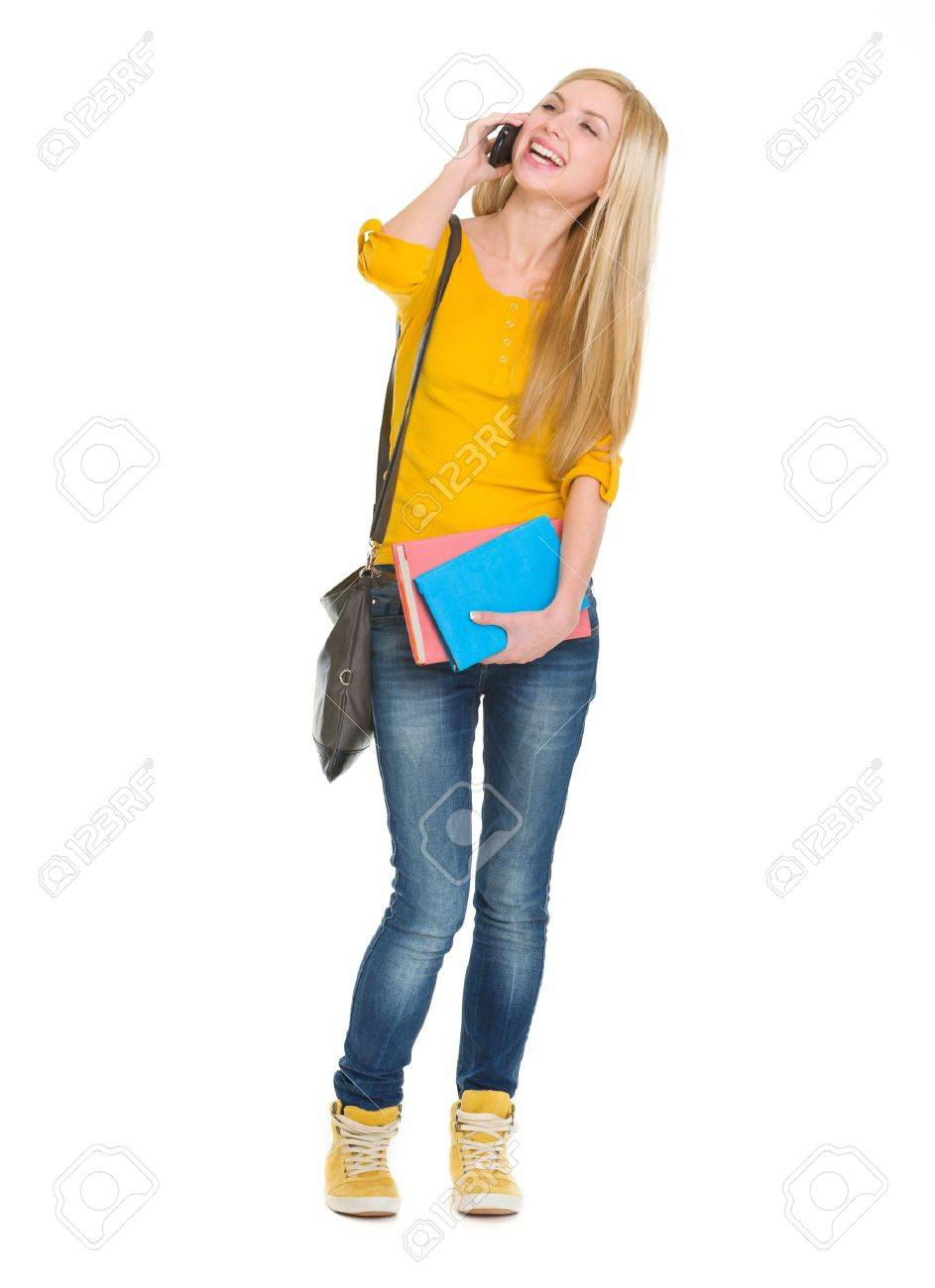 Full length portrait of smiling student girl talking mobile phone Stock Photo - 18204640