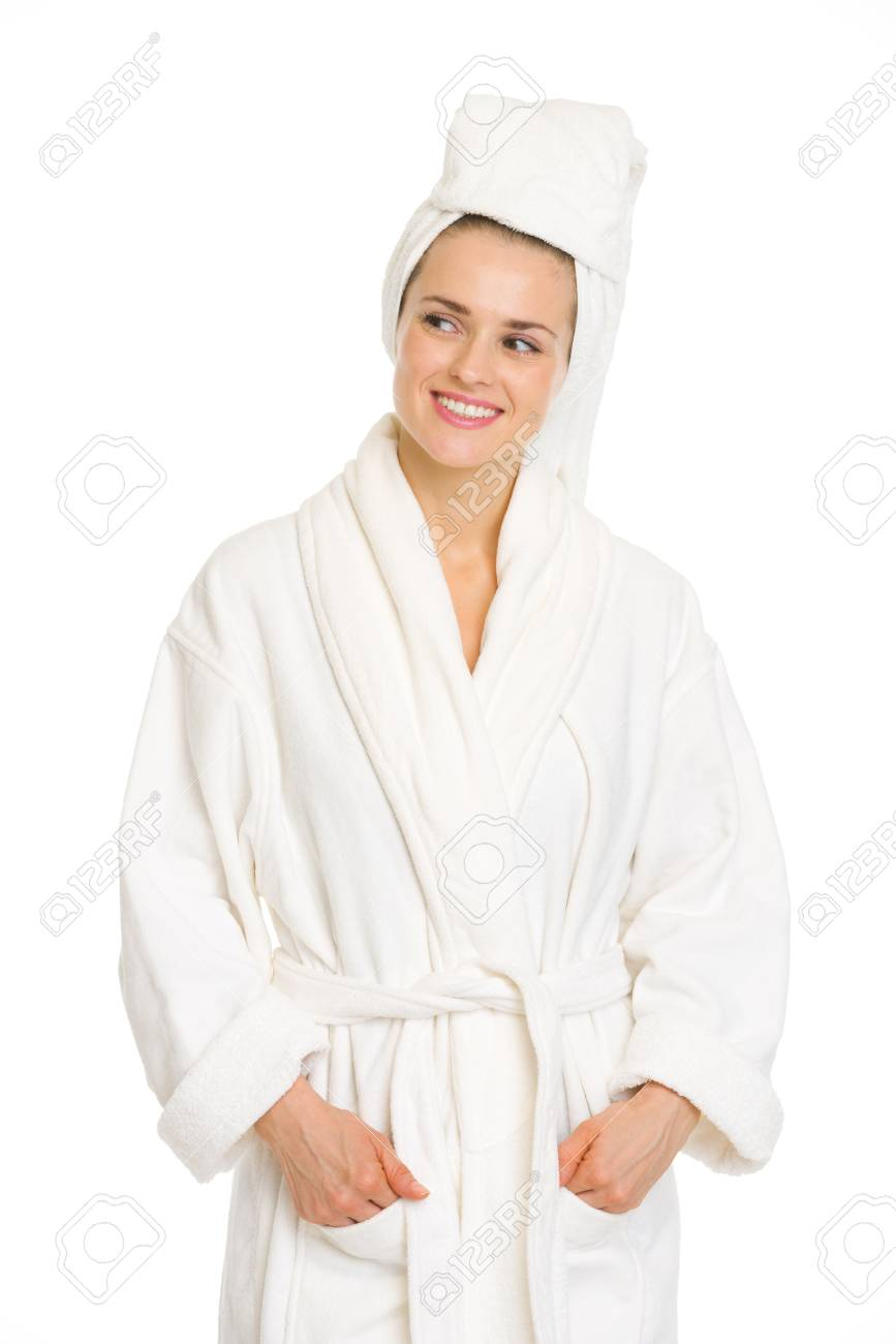 Young woman in bathrobe looking on copy space Stock Photo - 18493246