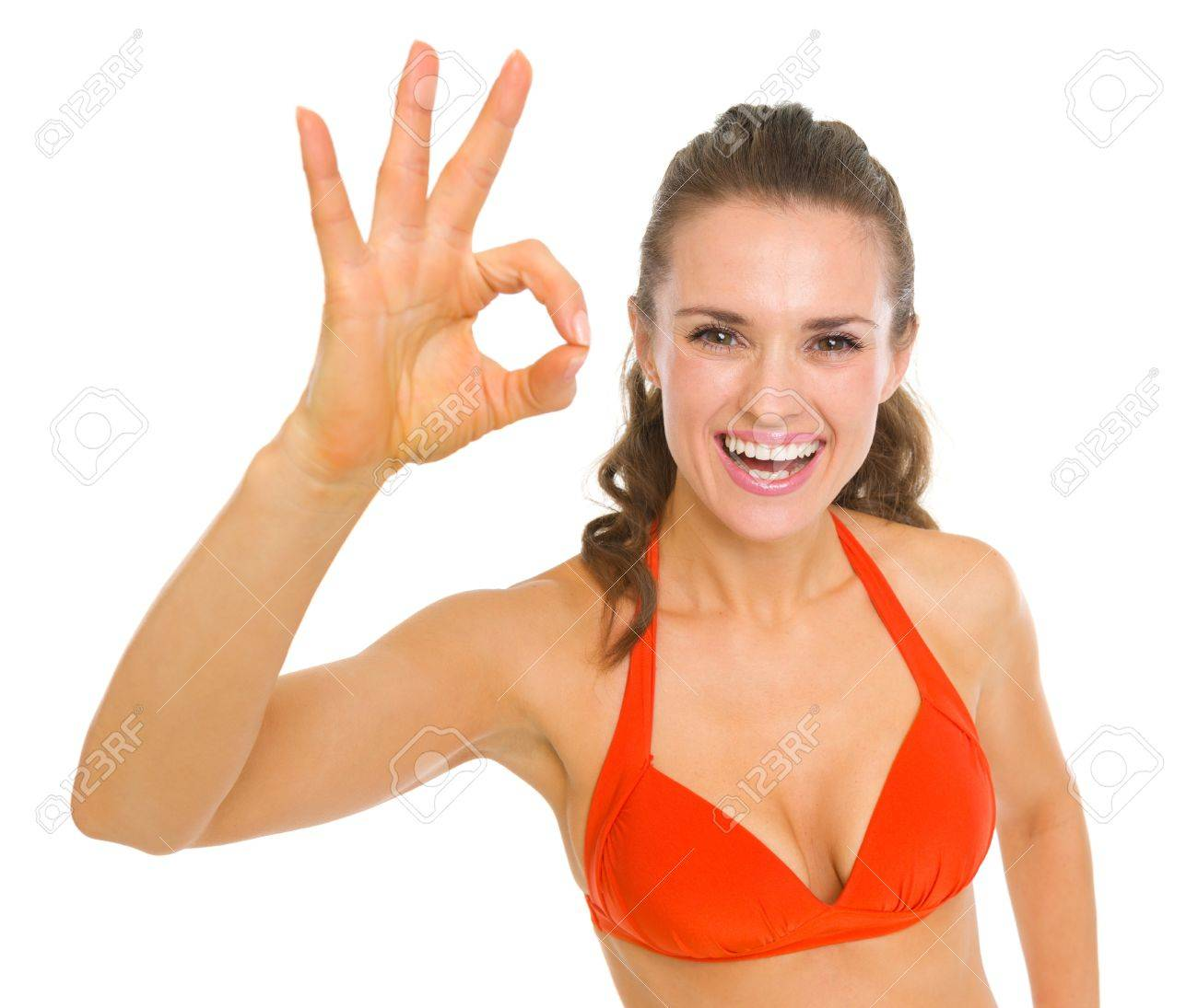 Happy young woman in swimsuit showing ok gesture Stock Photo - 18625074