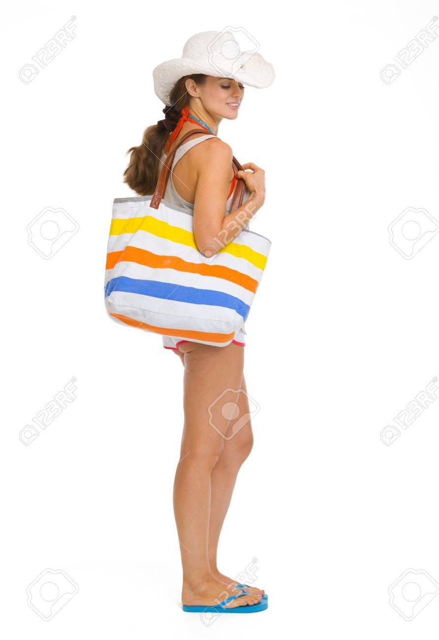 Full length portrait of happy young beach woman in hat Stock Photo - 18649315