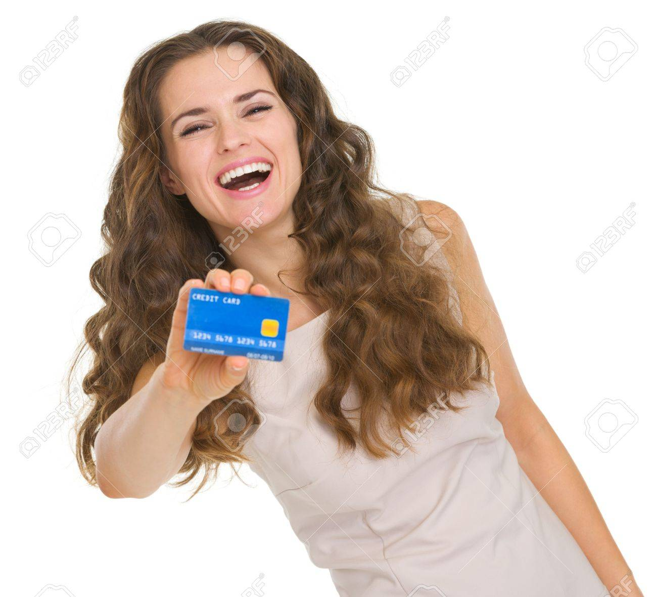 Portrait of happy young woman showing credit card Stock Photo - 18788132