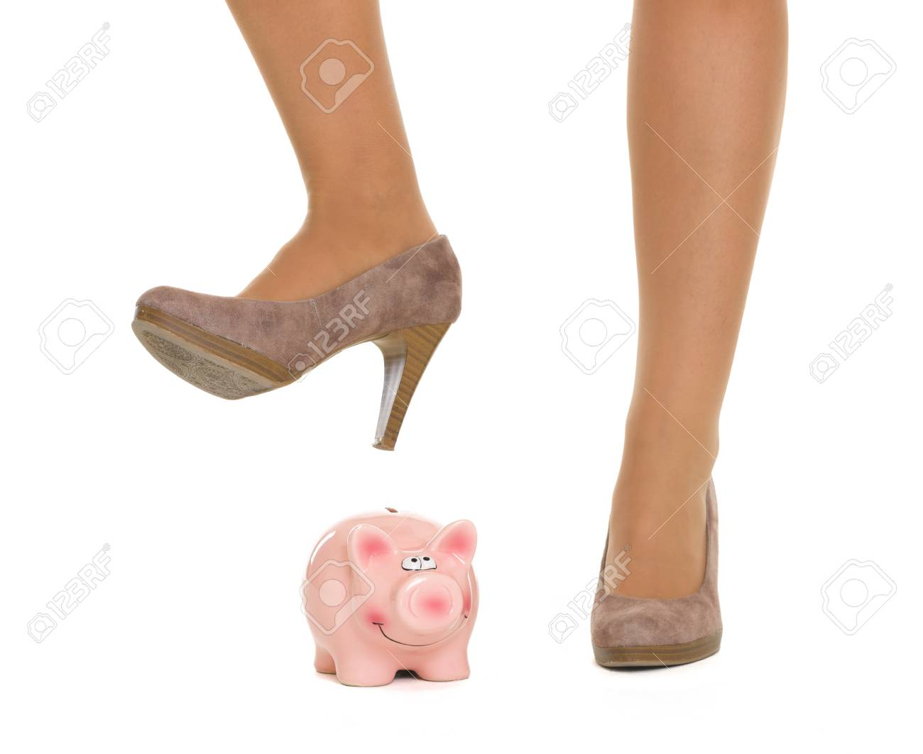 Closeup on woman leg breaking piggy bank Stock Photo - 18788211