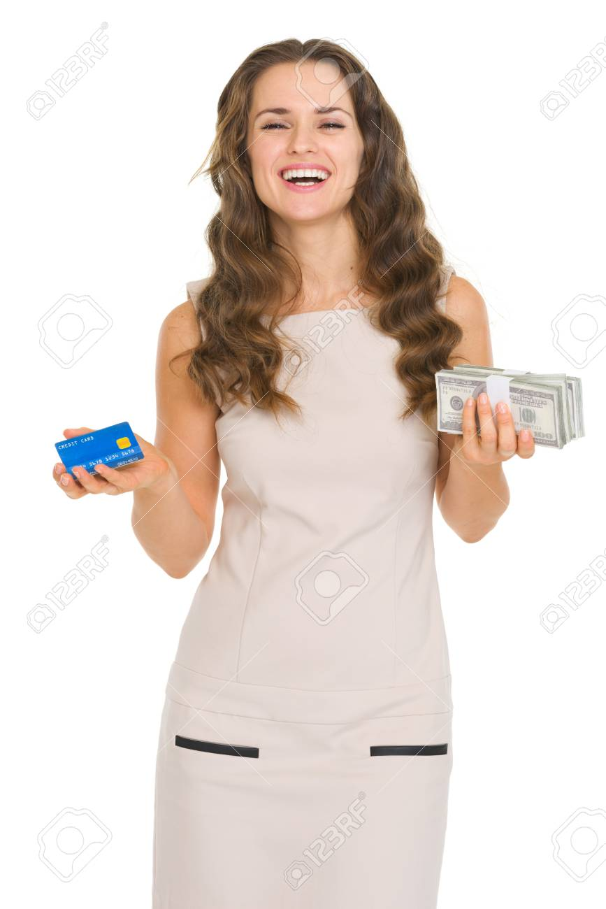 Happy young woman holding credit card and money packs Stock Photo - 18788107