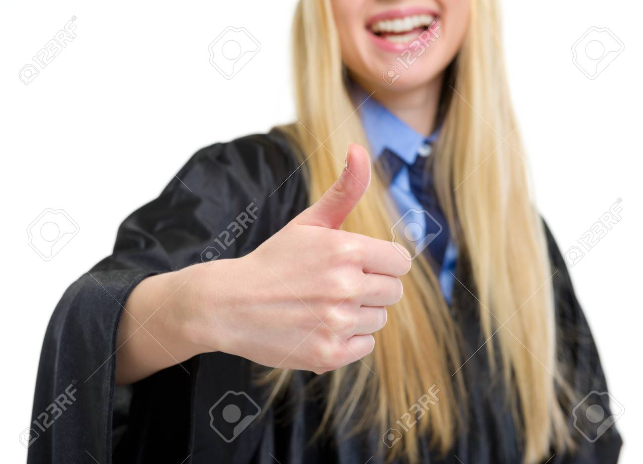 Closeup on young woman in graduation gown showing thumbs up Stock Photo - 18938271