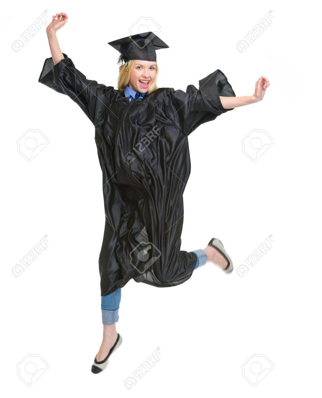 Full Length Portrait Of Young Woman In Graduation Gown Jumping Stock ...