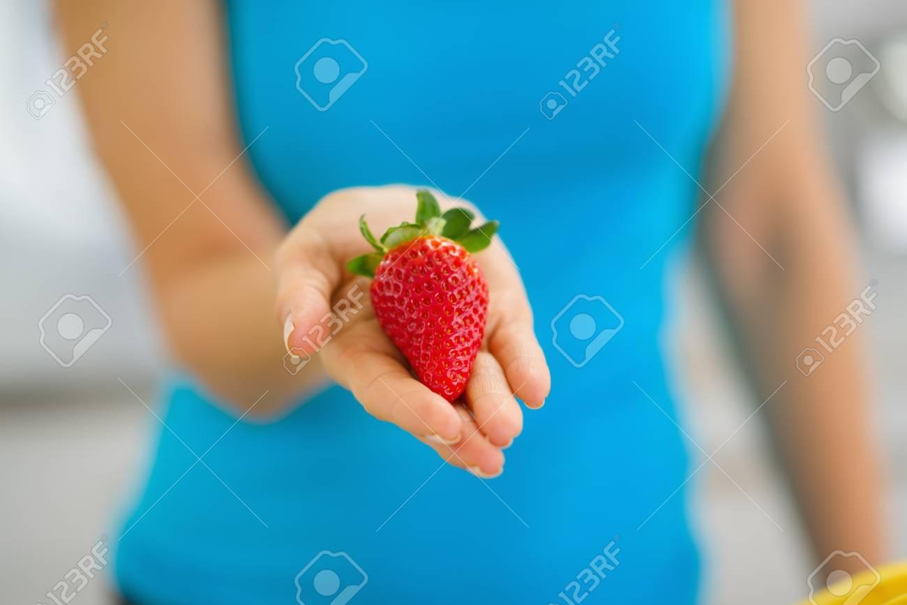 Closeup on woman showing strawberry Stock Photo - 19093447