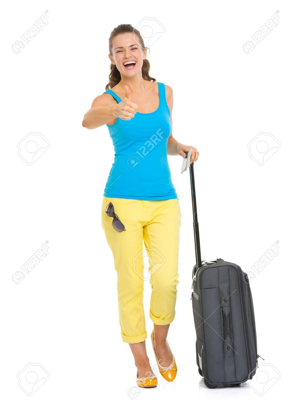 Full length portrait of happy young tourist woman with wheel bag showing thumbs up Stock Photo - 19339966