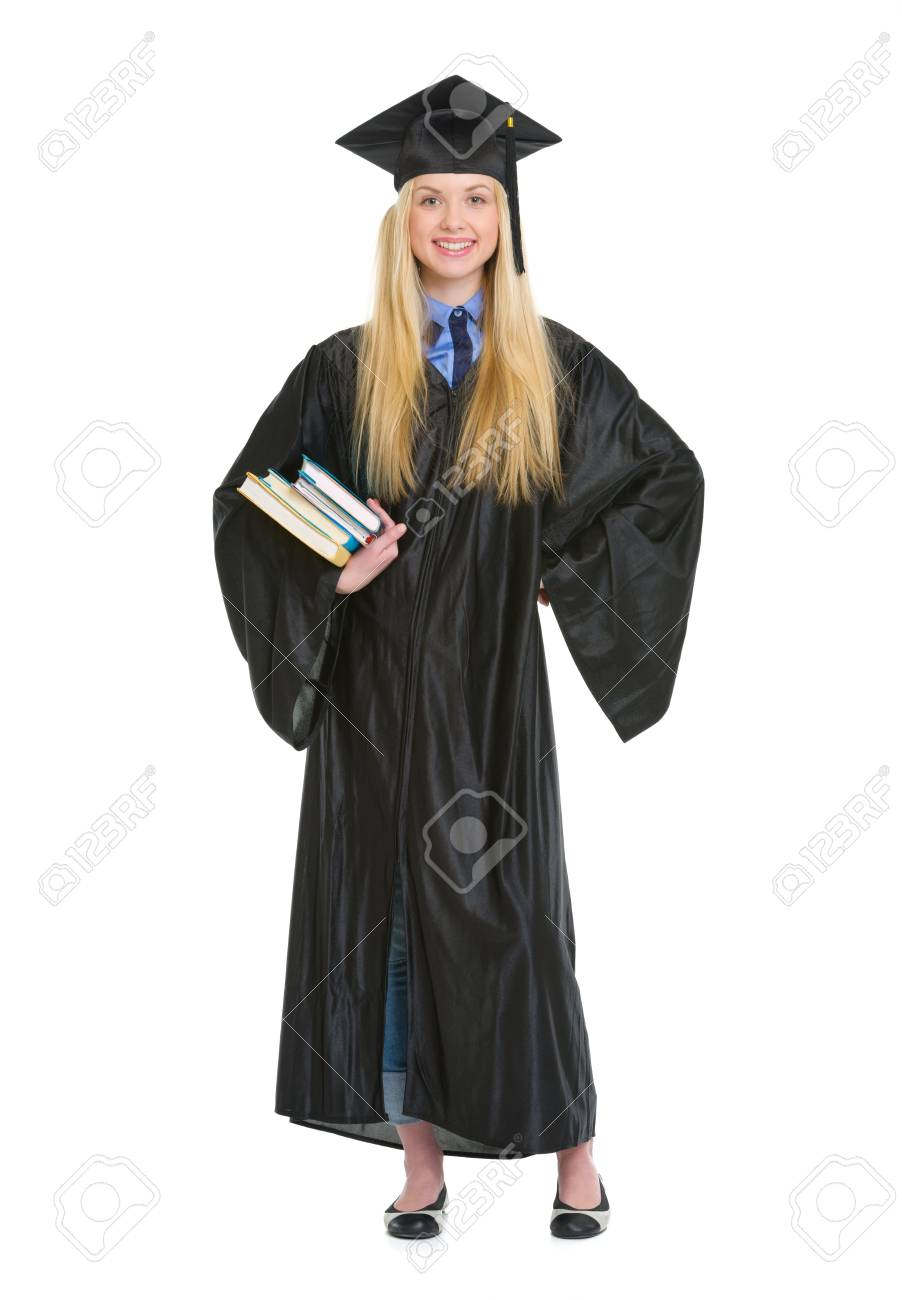 Full Length Portrait Of Young Woman In Graduation Gown With Books ...